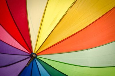 The top of a rainbow-colored umbrella pointing downward.