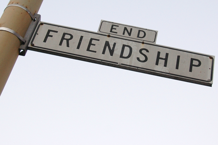 "Road sign with words ""End Friendship"""