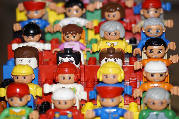 Rows of little plastic human toys in a variety of occupations, ages, and skin tones.