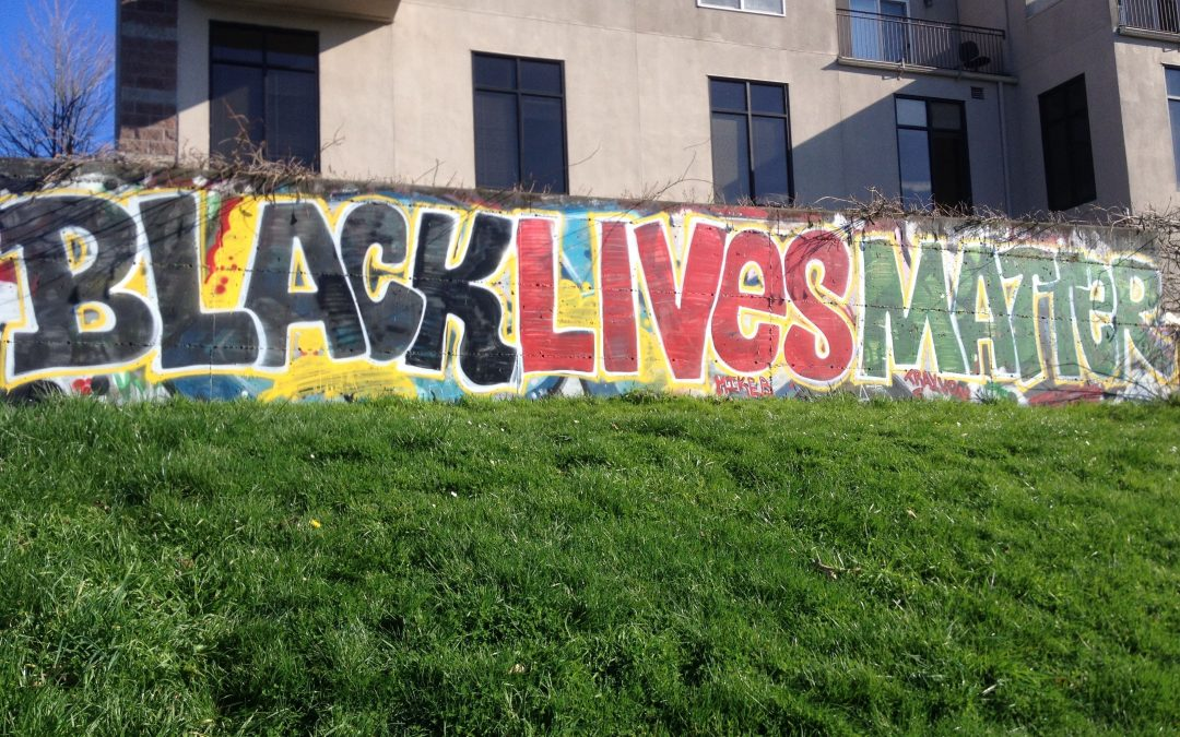 Street art reads BLACK LIVES MATTER.