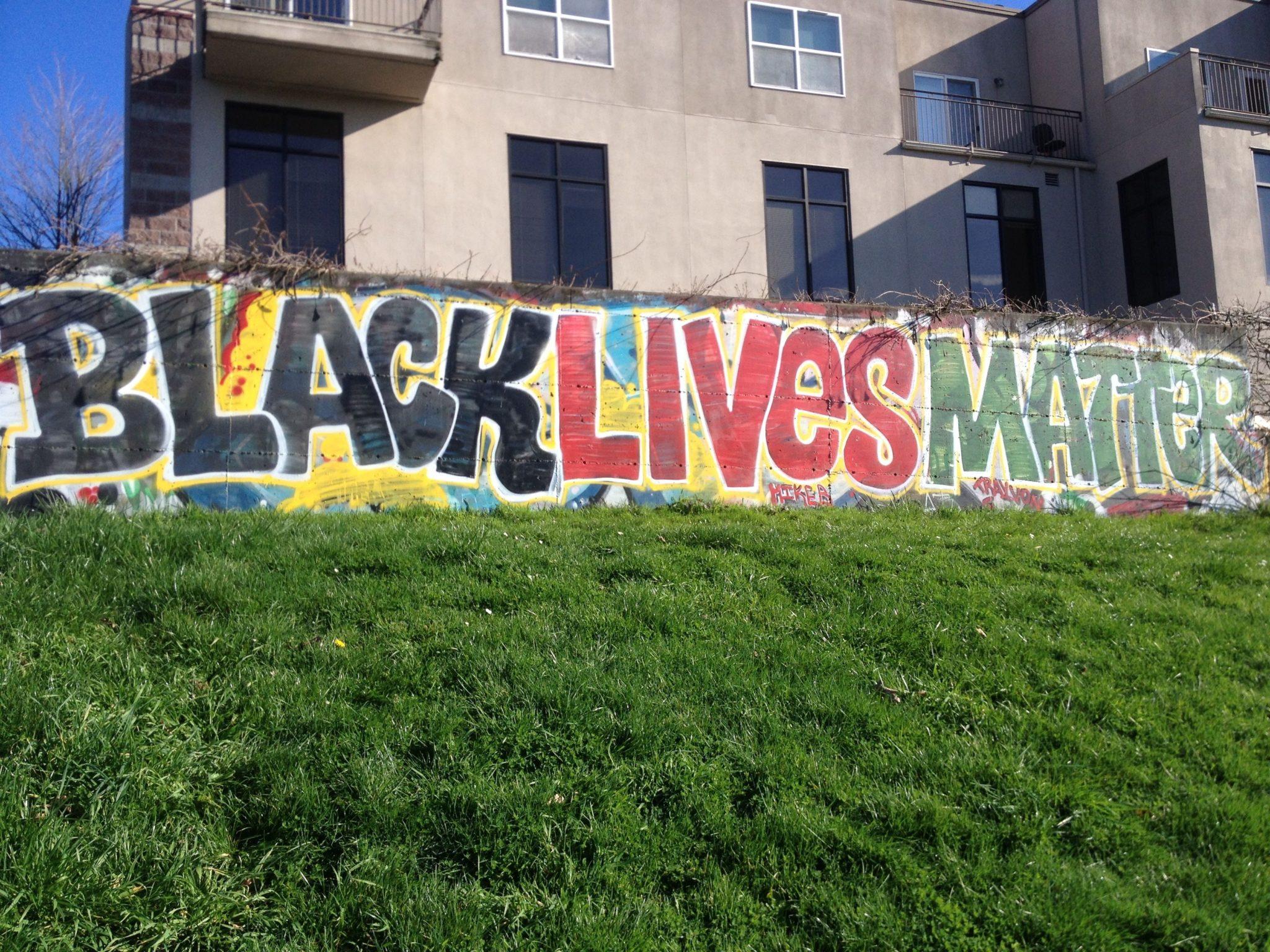 Street art reads BLACK LIVES MATTER.
